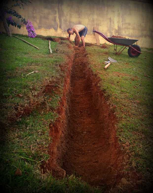we are digging trenches to capture & store water in this steep garden